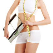 Pretty woman with glass scale and measure tape — ストック写真