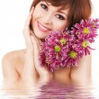 Cute young woman with flowers — Stock Photo #14974847