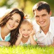 Happy mother, father and daughter in park — Stock Photo #14975017
