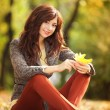 Young pretty woman resting in the autumn park — Stock Photo #14975161