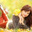 Young pretty woman resting in the autumn park — Stock Photo #14975195