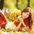 Young pretty woman resting in the autumn park — Stock Photo #14975197