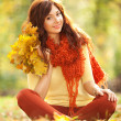 Young pretty woman relaxing in the autumn park — Stock Photo #14975245