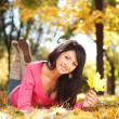 Young pretty woman resting in the autumn park — Stock Photo