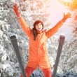 Happy girl with ski in the winter landscape — Stock Photo #15217897