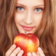 Stock Photo: Portrait of a young woman with red apple