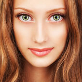 Portrait of a young woman with beautiful hair and green eyes — Stock Photo