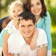 Happy mother, father and daughter in park — Stock Photo #16376473