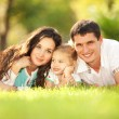 Happy mother, father and daughter in park — Stock Photo #16376495