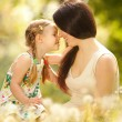 Mother and daughter in park — Stock Photo #16496247