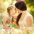 Mother and daughter in the park — Stock Photo #16496247
