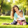 Mother with daughter in the park — Stock Photo #16496361