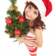 Santa woman with christmas tree. Wide angle — Stock Photo #16496433