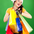 Fun santa woman with color packages — Stock Photo #16496453
