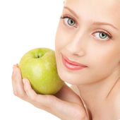 Portrait of a young woman with green apple — Stock Photo