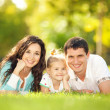 Happy mother, father and daughter in the park — Stock Photo #17153625