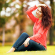 Young pretty woman resting in the park — Stock Photo