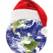 Earth with santa hat — Stock Photo