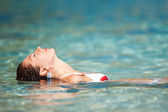Young woman relaxing in the water — Stock Photo