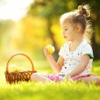 Cute little girl eating apple in the park — Stock Photo #17355871