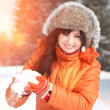Happy girl playing with snow in the winter landscape — Stok fotoğraf