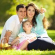 Happy familyin the green garden — Stock Photo