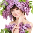 Young womwith lilac flowers — Stock Photo #17844013