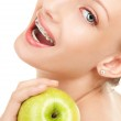 Cute girl in braces with green apple on white background — Stock Photo
