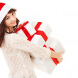 Happy santa woman with gift boxes - Stockfoto