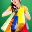 Fun santa woman with color packages — Stock Photo #17844245