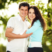 Young happy couple in the park — Stock Photo