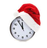 Clock with christmas santa hat — Stock Photo