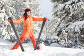 Happy girl with ski in the winter landscape — Stock Photo
