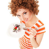 Fun woman eating the cake on the white background — Foto Stock