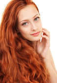 Portrait of a young woman with red hair and green eyes — Stock Photo