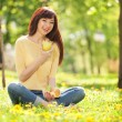 Happy woman eating fruits in the park — Stock Photo #21942461