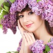 Young woman with lilac flowers — Stock Photo #21942509