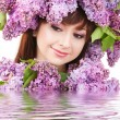 Young woman with lilac flowers — Stock Photo #21942525