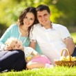 Happy family having a picnic in the green garden - Stock fotografie