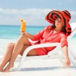 Fashion woman drinking cocktail on the beach — Stock Photo #21942749