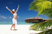Happy woman on the tropical beach — 图库照片