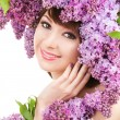 Young woman with lilac flowers — Stock Photo #22746295