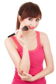 Young woman with brushes for makeup isolated on white background — Stock Photo