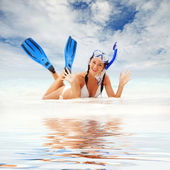 Happy woman with snorkeling equipment on the beach — Stock Photo