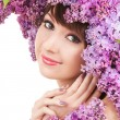 Young woman with lilac flowers — Stock Photo #23798503