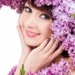 Young woman with lilac flowers — Stock Photo #23893353