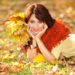 Young pretty woman relaxing in the autumn park — Stock Photo #23893387