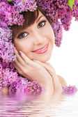 Young woman with flowers on white background — Stock Photo