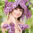 Young woman with lilac flowers — Stock Photo #25976771