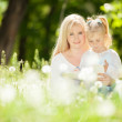 Mother and daughter in the park — Stock Photo #26031299